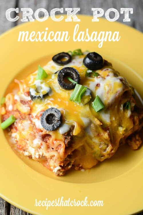 Crock Pot Mexican Lasagna: The perfect slow cooker dish for your next family fiesta! Layers of salsa, noodles, cheese, taco meat and a delicious bean mixture make this an instant family favorite!